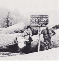 Virginia Best Adams beside warning sign at Glacier Point.