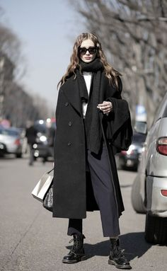 winter street style - oversized black melton coat - black scarf - navy tailored trousers worn with black doc martin boots... - Street Style