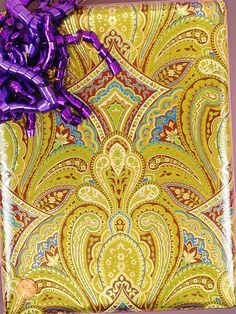 Stylized Gold and Purple Paisley Paper