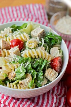 This Chicken Caesar Pasta Salad is a great meal or side dish. It's loaded with crisp romaine, pasta, herbed chicken, ripe cherry tomatoes and lots of cheese!