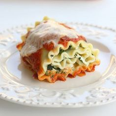 Healthy Spinach Lasagna Rolls Recipe Main Dishes with lasagna noodles, frozen chopped spinach, nonfat ricotta cheese, grated parmesan cheese, eggs, minced garlic, italian seasoning, salt, pepper, chicken breasts, tomato sauce, part-skim mozzarella cheese