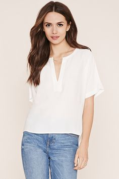 Forever 21 Contemporary - A short-sleeved woven top complete with a split neckline and a vented hem.