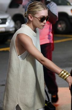 Ashley Olsen in a simple knit and low bun.
