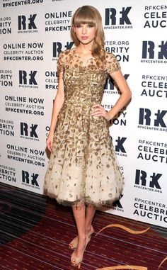 Taylor Swift from Oscar de la Renta's Top Red Carpet Looks  The stylish singer opted for a fun and feminine look with a fit-and-flare tulle dress decorated with gorgeous goldlamé embroidery at the 2012 Ripple of Hope Gala.