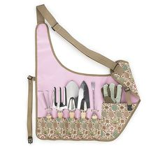 #burtonandburton Apron gardening set with set of 5 tools and gloves. Khaki with pink floral pattern on pockets. tools include two shovels, cultivator, fork