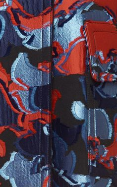 This **Emilio Pucci** coat features a jacquard construction in a floral design.