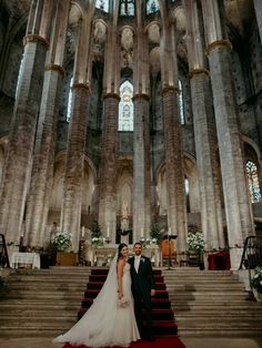 Bride and groom exchanging vows in gothic dark academia wedding venue church