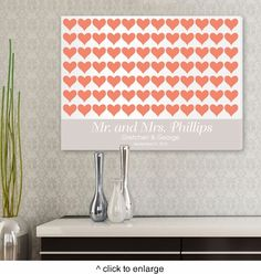 """The red hearts on this signature For the Love of Hearts wall art will brighten up any room! A lovely bridal shower, wedding, or anniversary gift, it's appropriate for couples of any age! Measuring 18 x 24"""" and featuring space for first names and date, this canvas print is a wonderful way to pay tribute to the bright spirit of love"""