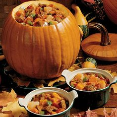 """Stew Baked in a Pumpkin Ѽ 2 lb beef stew meat, cut into 1"""" cubes; 3 TBsp canola oil, divided; 1 cup water; 3 large potatoes, peeled & cut into 1"""" cubes; 4 medium carrots, sliced; 1 large green pepper, cut into ½"""" pieces; 1-4 garlic cloves, minced  1 medium onion, chopped; 2 tsp salt; ½ tsp pepper; 2 TBsp beef bouillon granules  14½ oz can diced tomatoes, undrained; 10-12 lb pumpkin"""