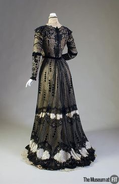 Evening dress  Callot Soeurs  Black lace, white taffeta, sequins and rhinestones  c.1909  France