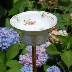 cute & i like the repurpose of old dishes - birdbath made out of a plate and a bowl