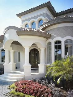 the audrey front entry by luxury home builders alvarez homes mediterranean elegance at its finest luxury homes - Luxury Homes Exterior Brick
