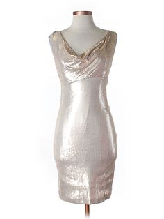 The ultimate metallic party dress by Nicole MIller.