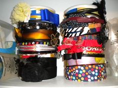 Headband storage!  Use empty oatmeal containers!  Tried this last night when I was getting frustrated by all of Abbey's headbands.  It works great!