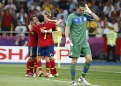 Spain's Juan Mata (obscured) celebrates with team mates after he scored the winning goal against Italy's Gianluigi Buffon (R) during their Euro 2012 final soccer match at the Olympic Stadium in Kiev, July 1, 2012.