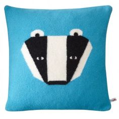 """Donna Wilson's """"badger collection"""" pillows. Makes you wonder what the honey badger would do...?"""