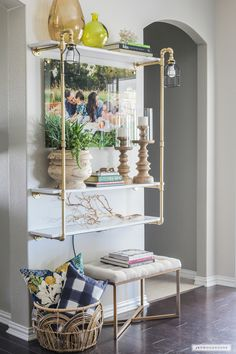With a few supplies from The Home Depot plumbing and lighting department, you can make a beautiful DIY lighted pipe shelf.