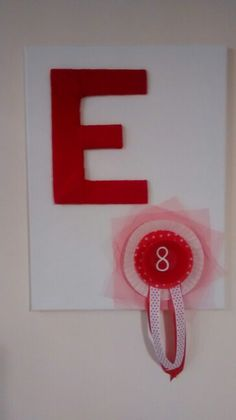 Canvas with woven E & cupcake liner rosette