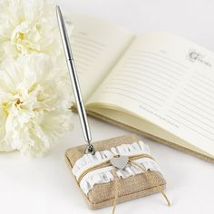 This rustic romance burlap guest book pen will look absolutely charming on any country chic wedding reception sign in table.