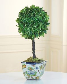 A lovely mix of boxwood and pittosporum perched atop a trunk of three natural stems, Balsam Hill's Boxwood Topiary in Tuscan Planter features silk polyester leaves which have each been shaped and painted by hand to achieve a realistic look. #MothersDay #GiftIdeas