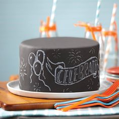 Chalkboard Fondant Cake from @michaelsstores. Write your celebration message on this clever fondant-covered chalkboard cake. It's easy to cover the cake using Wilton® Black Decorator Preferred™ Fondant and to add the message with Wilton® Bright White Candy Melts® Candy.