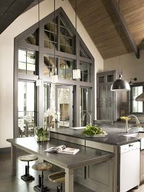 This has so much wow, between the use of interesting materials to the beautiful window and dramatic colors.