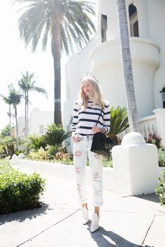 Shea Marie wearing distressed jeans and a striped top