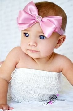 Pink bow -- Who's looking at the bow!? Look at this beautiful baby!