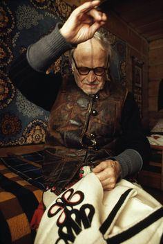 Tailor sewing a pair of traditional trousers