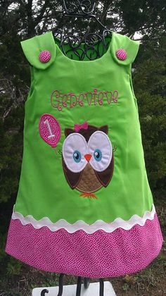 """You will have a """"hooting"""" good time with this precious applique birthday Look Whoo's Turning (1,2,3 or all the way to age 12) Owl Aline Dress.  It is the perfect birthday clothing for your little princess.     We have appliqued and monogrammed a cute cute owl holding a birthday balloon.. Towards the bottom of the dress is hot pink polka dot fabric made to match the fabric on the balloon. The fabric is trimmed with white ric rac ribbon. The dress has pink buttons for closure."""