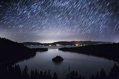 Emerald Bay, Lake Tahoe, CA is one of my favorite places to go when I can't sleep. I spend the night doing time lapse photography of the amazing night sky above the glassy bay.   This photo is a conversation starter. You and your friends will be WOWed by it.