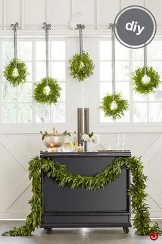 Sometimes a little ribbon is all you need to DIY a festive holiday bar area. Use our Sugar Paper for Target collection's black-and-white ribbon to hang wreaths that'll instantly freshen up your space and add a natural, wintry vibe. A garland of leaves strung across a sidebar or bar cart is the perfect complement.