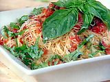 Fresh Tomato, Basil, and Garlic Sauce over Angel Hair Pasta Recipe.  This was yum--and I cheated and used canned tomatoes!