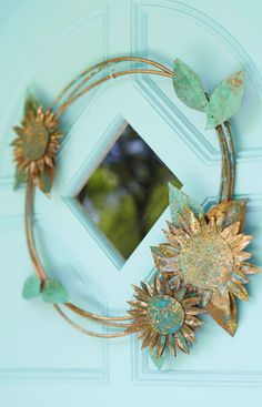 Copper coils decorated with a sunflower motif add elegance to a front door or interior wall. Allow the copper to weather naturally or add an instant patina.