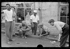 Marion Post Wolcott FSA Shooting craps by company store Osage West Virginia 1938-12