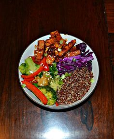 Korean BBQ Tofu Bowl combines delicious BBQ tofu with quinoa, sauteed vegetables, and fresh red cabbage.