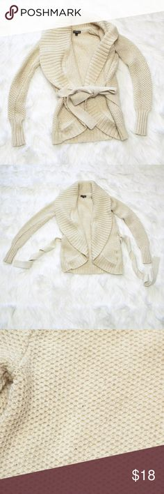 """❗️3 for $12❗️ Express Belted Cardigan This is a beautiful Express cardigan sweater, featuring a shawl collar and open front with removable tie belt at the waist. Heavy and warm merino wool blend. Yellowish-cream color with gold all over metallic detail. Size XS/S. Has moderate pilling and a few small pulls, but plenty of life left.   Measures approx. 15"""" armpit to armpit Approx. 23"""" L from shoulder to hem  🚫no trades 🚫no modeling ✅dog friendly/🚭smoke free home ✅reasonable offers ✅bundle…"""