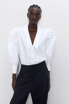 Collared blouse featuring long puff sleeves, tuck details on the front and a button-up front with faux pearl buttons. HEIGHT OF MODEL: 177 cm. Blouse Styles, Blouse Designs, Iranian Women Fashion, Minimal Outfit, Oversized Blouse, Quirky Fashion, Basic Outfits, Fashion 2020, Shirt Blouses