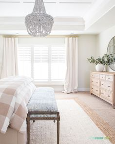Master bedroom with beaded chandelier, gingham bedding, blue and white bench, and jute rug. Decor, Home Remodel Costs, Home Remodeling, Cheap Home Decor, Home Decor, Gothic Home Decor, French Style Chairs, Bedroom Decor, Living Decor