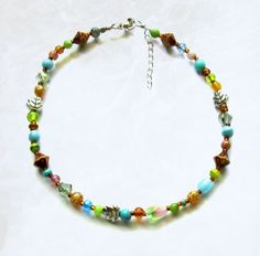 Maggies Beadery womens multi-colored anklet with chain is 10 1/4 to 11 inches long. It closes with a small but secure sterling silver clasp.