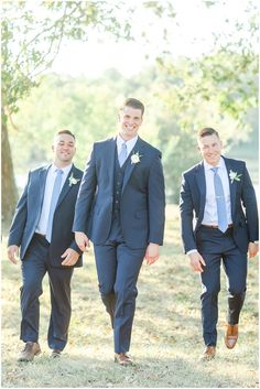 Groomsmen in navy suits with dusty blue ties. Groomsmen Attire Suspenders, Blue Groomsmen Suits, Cowboy Groomsmen, Groomsmen Socks, Groom Outfit, Blue Suit Groom, Country Groomsmen, Groomsmen Flask, Groom Attire