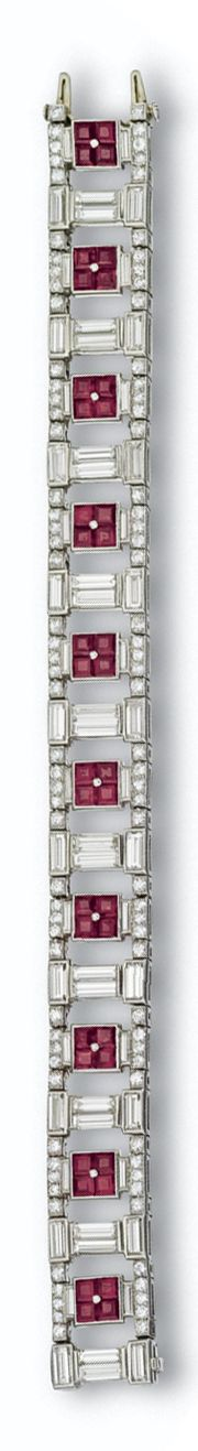 RUBY AND DIAMOND BRACELET, CIRCA 1930 The flexible openwork band of ladder design decorated with square-cut rubies set in fours, alternating with pairs of baguette diamonds, within a border of alternately set round and baguette diamonds, the whole set with 100 round and 60 baguette diamonds weighing approximately 14.75 carats, mounted in platinum, length 7 inches.