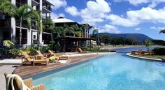 Blue Lagoon Resort Trinity Beach A 2-minute walk from Trinity Beach, this palm-fringed resort offers accommodation with balconies overlooking rainforest mountains. It features 3 outdoor pools and a tennis court. Free WiFi is available throughout the property.