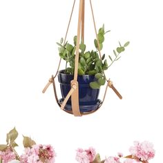 Elevate a humble houseplant with this vegetable-tanned leather plant hanger, handmade one by one in a Portland, OR-based studio. Made strong with thick, hand-cut leather straps, hand-hammered copper rivets, and brass rings, they're designed tohold almost any size pot.