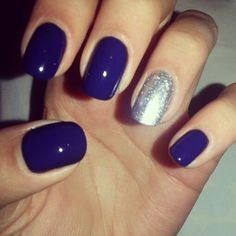 Navy cream nails with silver glitter accent