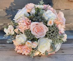 Blush peach and ivory rose bouquet with dusty miller and dried brunia…