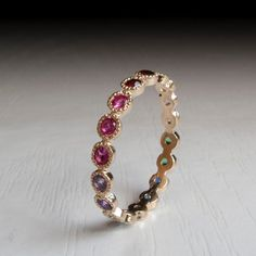 Hey, I found this really awesome Etsy listing at https://www.etsy.com/uk/listing/221173724/gold-eternity-ring-sapphire-ruby-citrine
