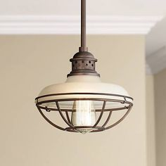 This mini pendant has a warm oil-rubbed bronze finish and soft white glass that is classic and inviting.