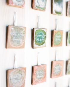 Ceramic tiles from Anthropologie, hand-painted with invitees' names, served as escort cards and favors at Joanna and Kyle's outdoor wedding in Charlottesville, Virginia.