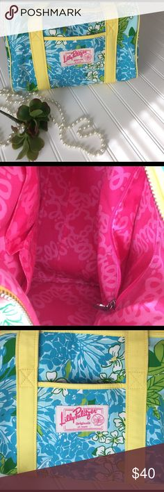 Lilly Pulitzer Bag Such a fun way to enjoy a Lilly print.  A zipper top bag with happy pink Lilly print fabric interior.  There is an outside patch pocket.  Two straps that reach about 8 inches from top of purse.  Will tuck nicely under your shoulder.  Straps are bright yellow on one side, natural canvas on other side. Has slight wear.  See photos.  Very roomy bag!! Lilly Pulitzer Bags Shoulder Bags